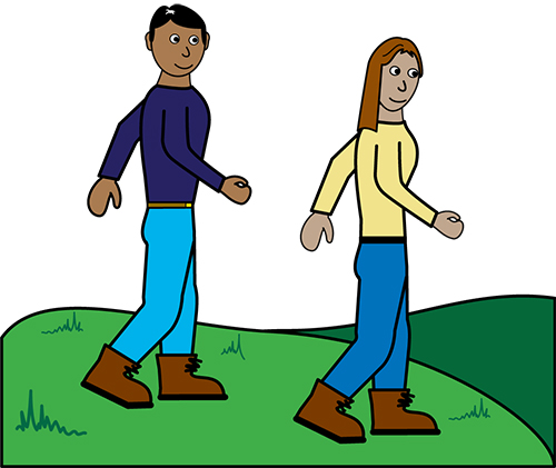 A man and a lady walking in a field.
