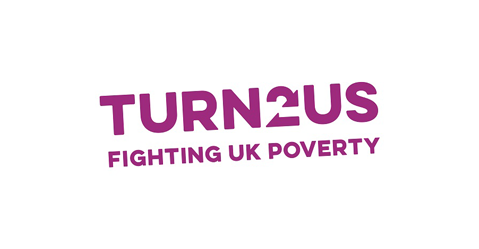 Tunr 2 Us logo. The words on the logo read Turn 2 us fighting UK poverty.