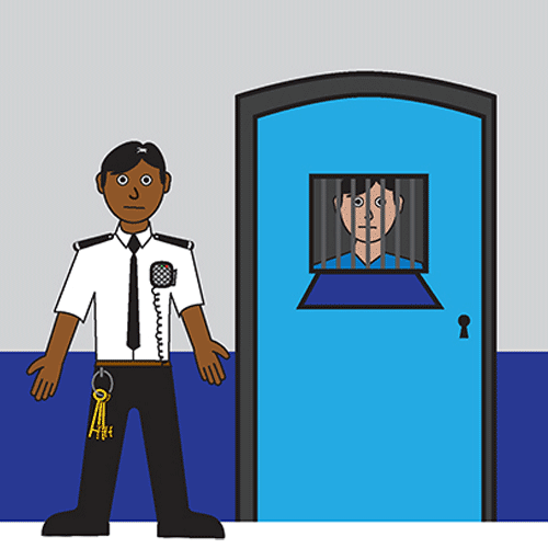 A man is in prison he is looking out of the bars from his jail cell. Just out side the door of the prison cell is a prison officer. The prison officer has a large bunch of keys attached to his trousers.