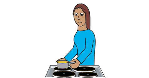 A woman is standing at a cooker that is a pan on the cooker.